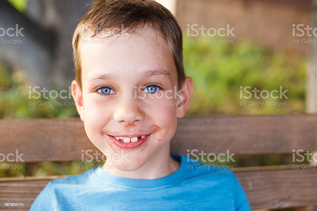cheerful boy ate chocolate ice cream stock photo