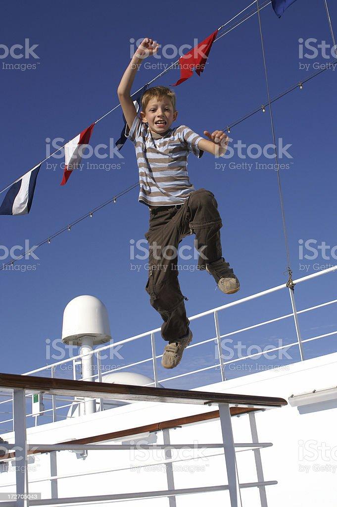 Cheerful boy on a ship stock photo