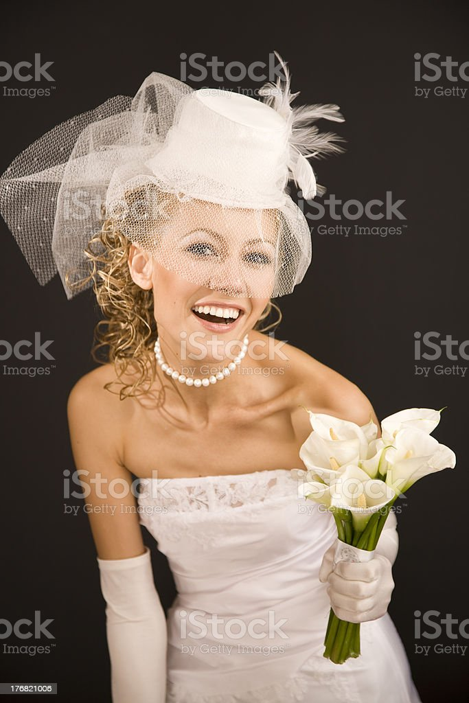 Cheerful bride dressed in  retro style royalty-free stock photo