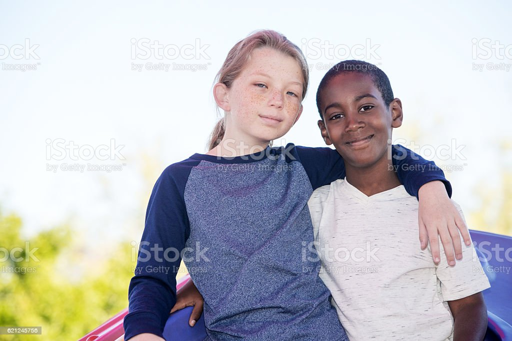 Cheerful brothers embracing outside stock photo