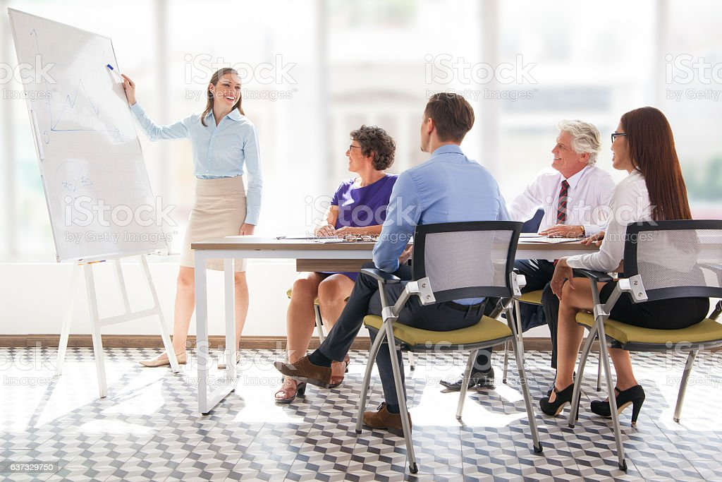 Cheerful business coach explaining strategy stock photo