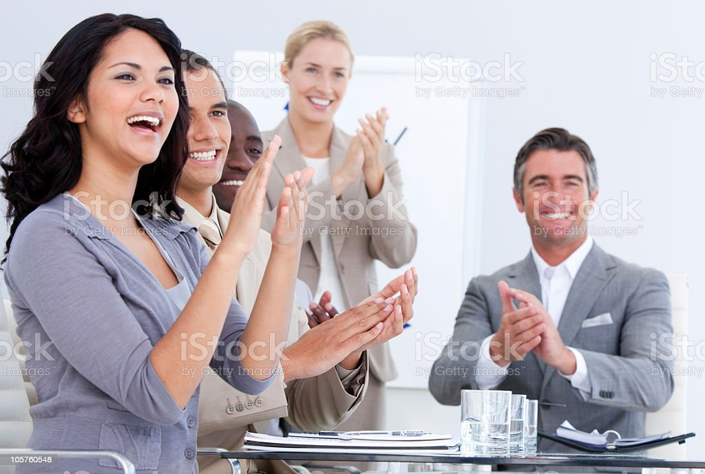 Cheerful business people applauding in a meeting royalty-free stock photo
