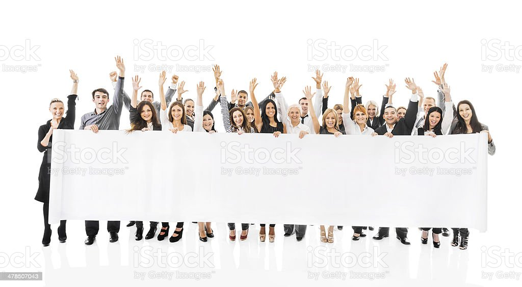 Cheerful business people holding banner. stock photo