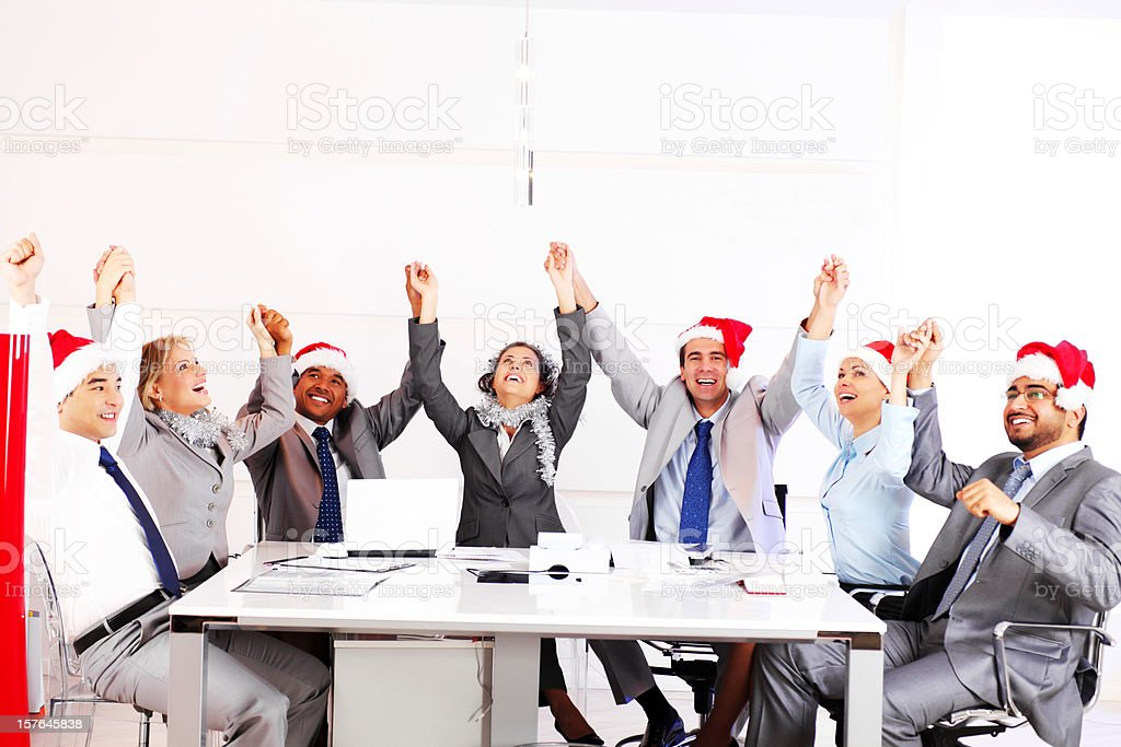 Cheerful business people in the spirit of New Year's emptied royalty-free stock photo