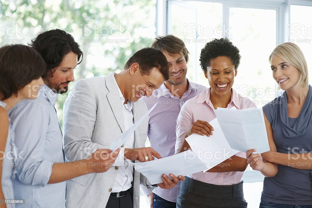 Cheerful business people looking at papers royalty-free stock photo