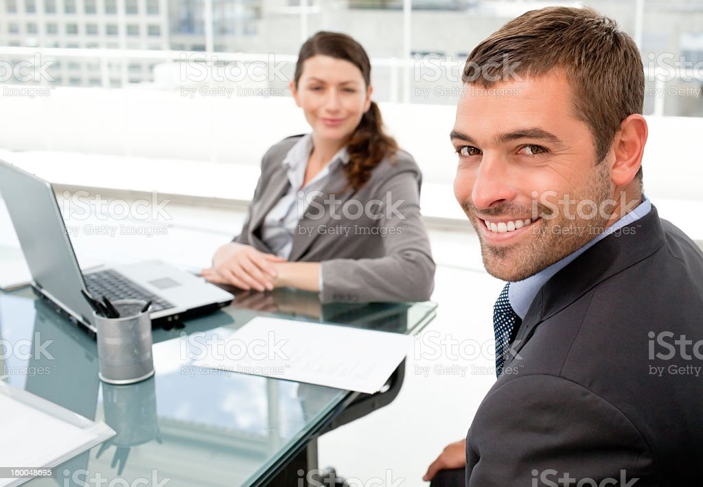 Cheerful business people working on  laptop during a meeting royalty-free stock photo