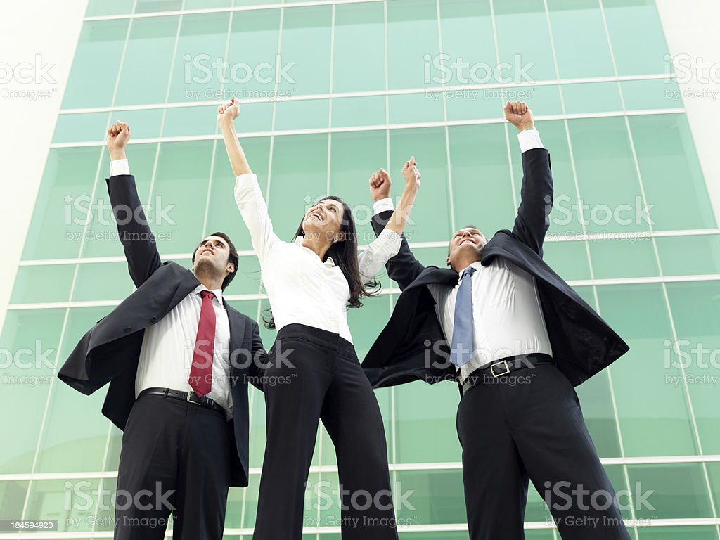 Cheerful business team celebrating royalty-free stock photo
