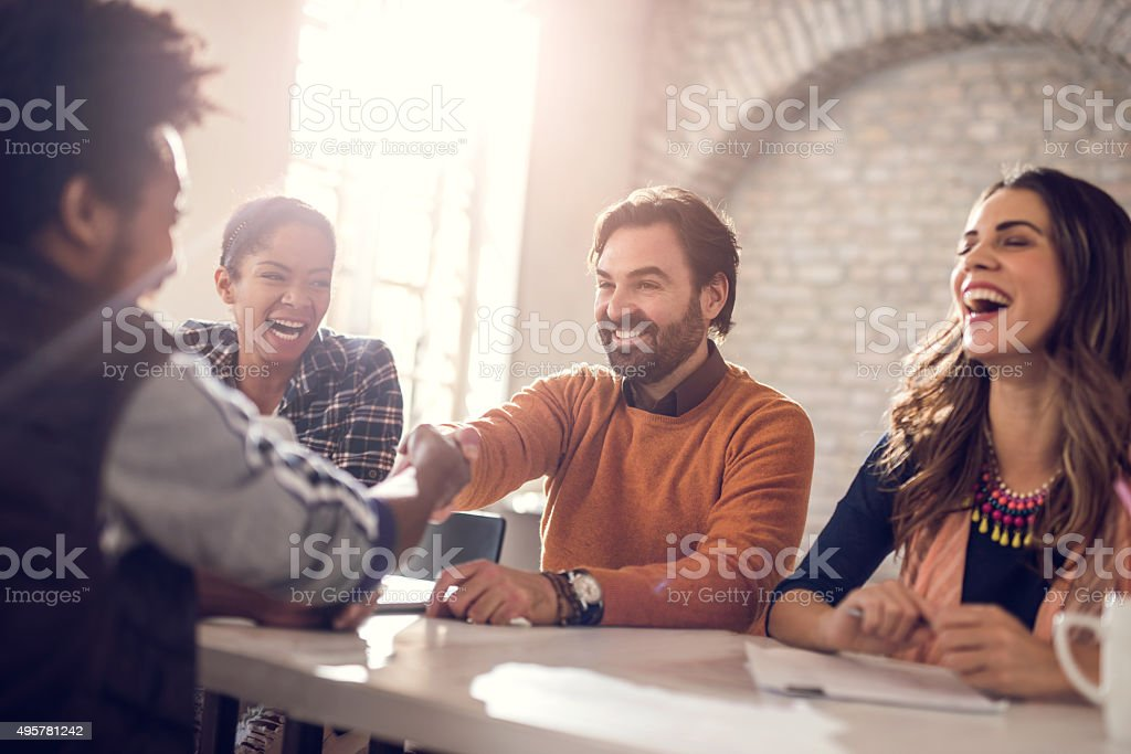 Cheerful business team congratulating a candidate on getting a job. stock photo