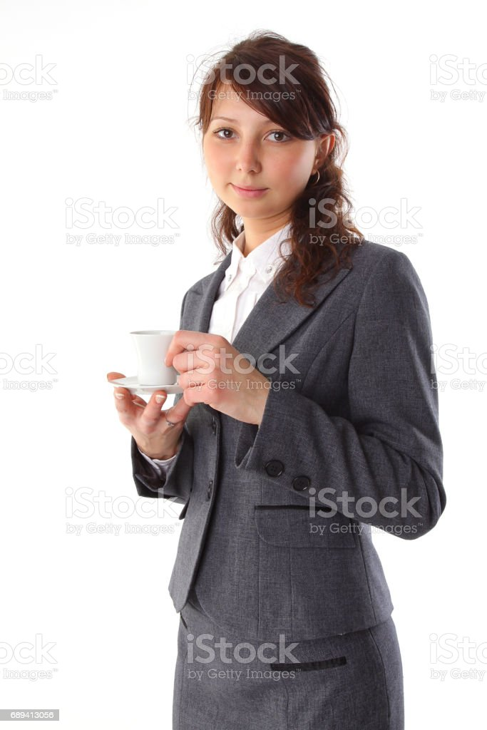Cheerful business woman holding coffee cup. Isolated against white background stock photo