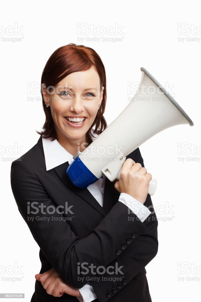 Cheerful business woman holding megaphone royalty-free stock photo