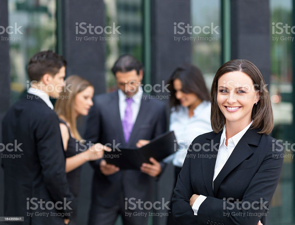 Cheerful business woman with her team royalty-free stock photo