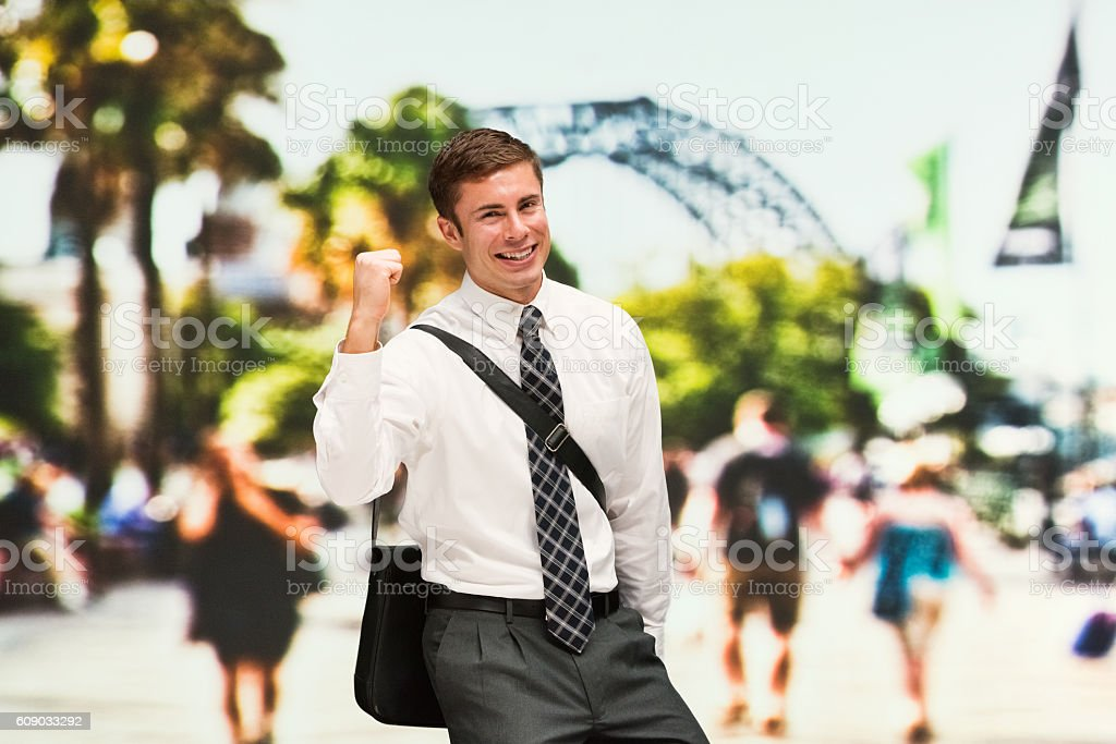Cheerful businessman cheering outdoors stock photo