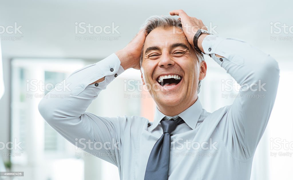 Cheerful businessman laughing stock photo