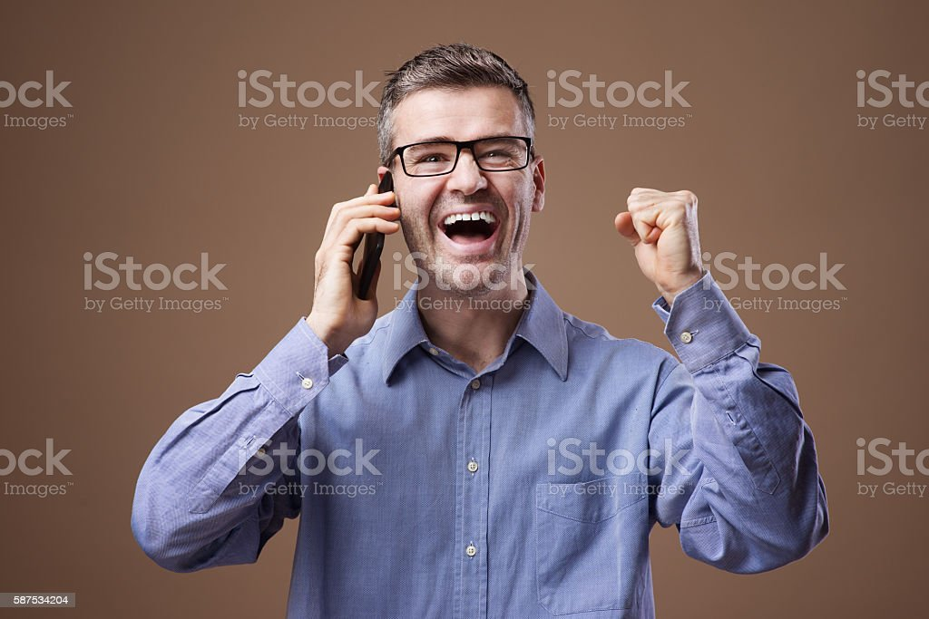 Cheerful businessman on the phone stock photo