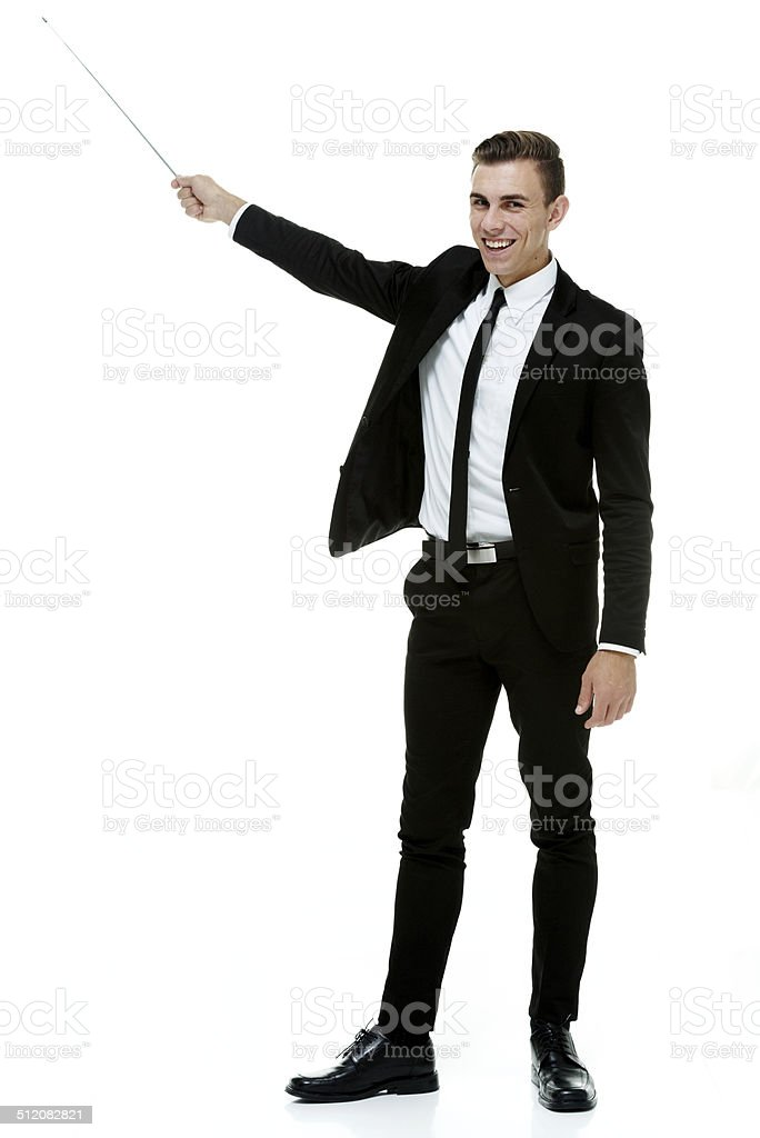 Cheerful businessman presenting with pointer stick stock photo