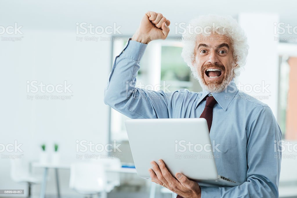 Cheerful businessman receiving good news stock photo