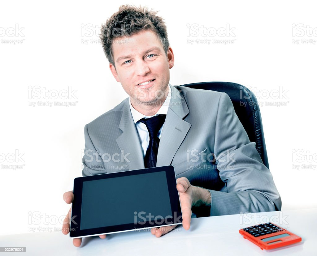 cheerful businessman showing the screen of his digital tablet stock photo