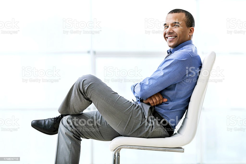 Cheerful businessman sitting on chair. royalty-free stock photo