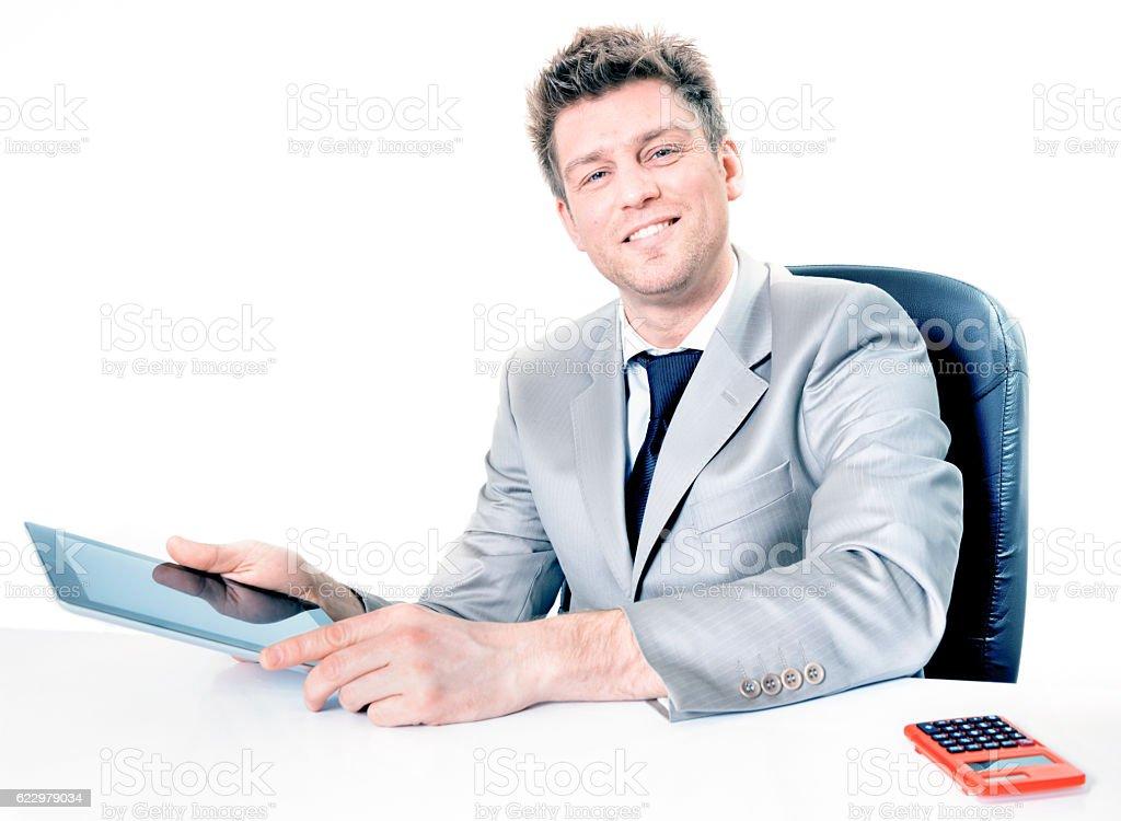 cheerful businessman using his digital tablet stock photo