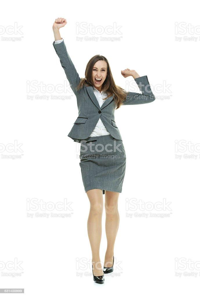 Cheerful businesswoman cheering stock photo