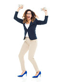 Cheerful businesswoman cheering with money