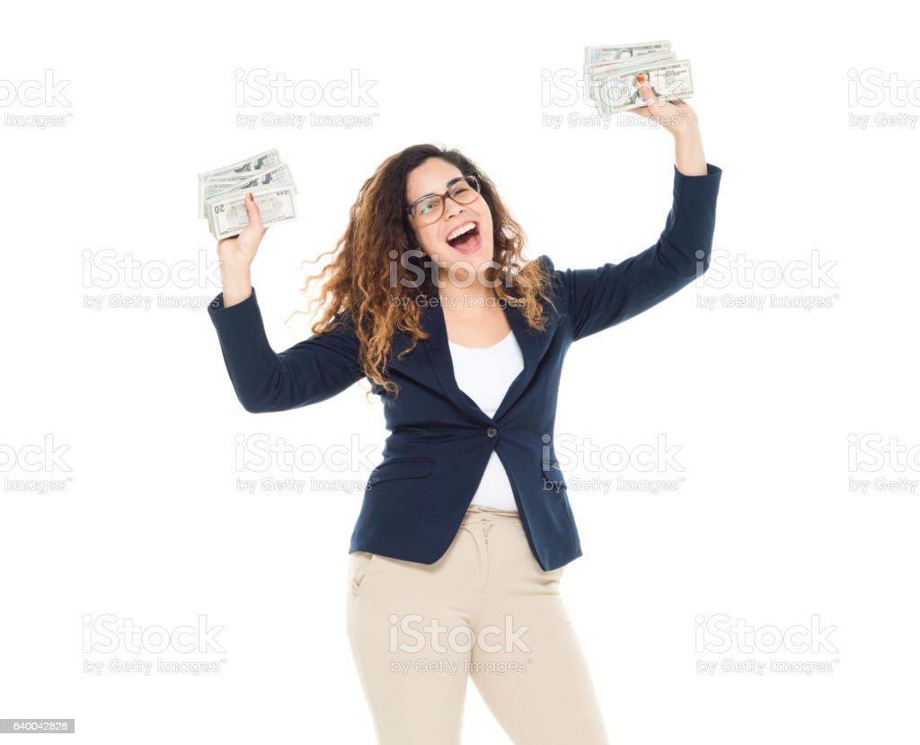Cheerful businesswoman cheering with money stock photo