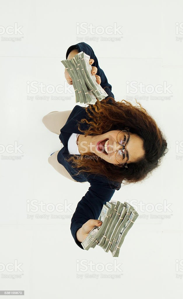 Cheerful businesswoman excited by money stock photo