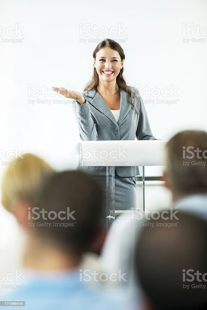 Cheerful businesswoman having a public speech. royalty-free stock photo