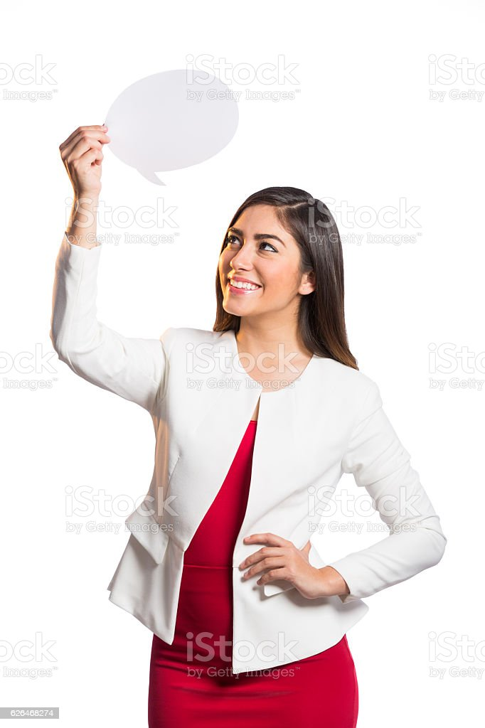 Cheerful businesswoman holding up speech bubble and looking up stock photo