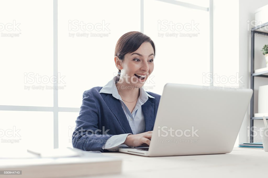 Cheerful businesswoman in her office stock photo