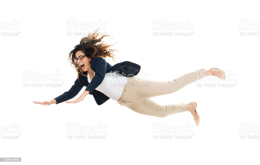 Cheerful businesswoman jumping and falling stock photo