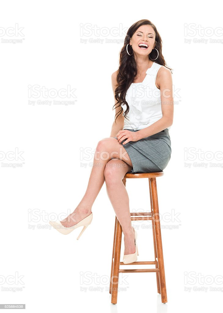 Cheerful businesswoman looking at camera stock photo