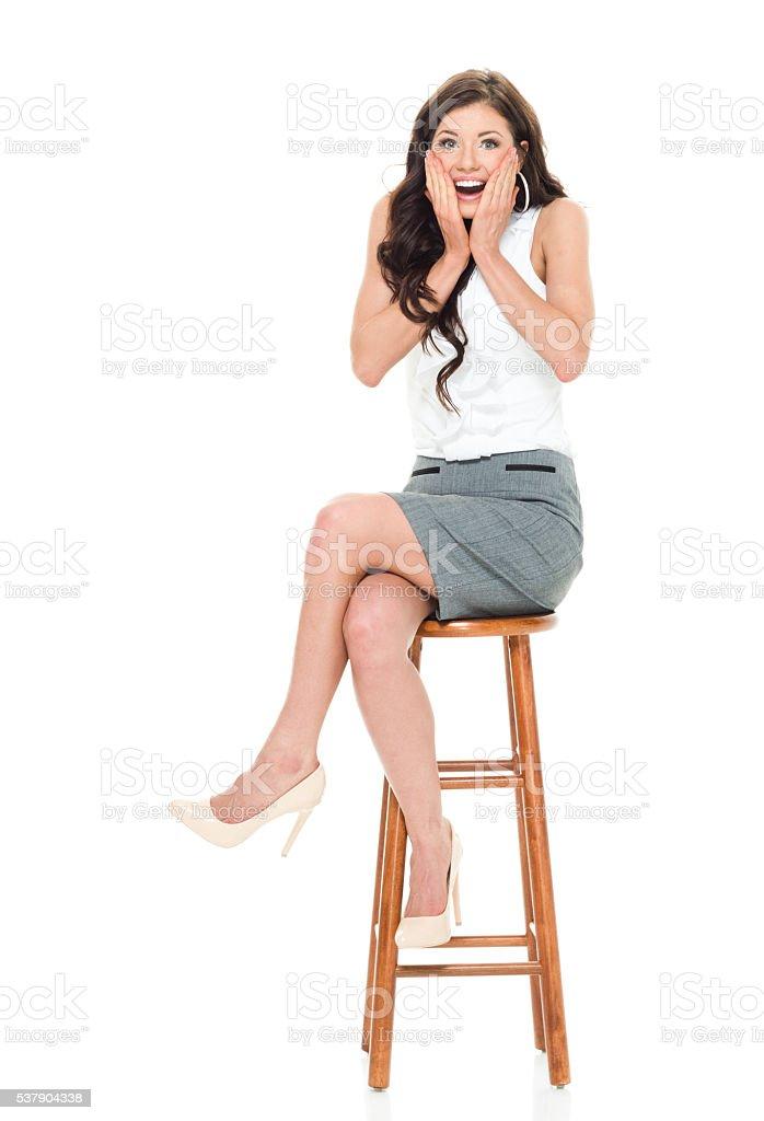 Cheerful businesswoman looking shocked stock photo