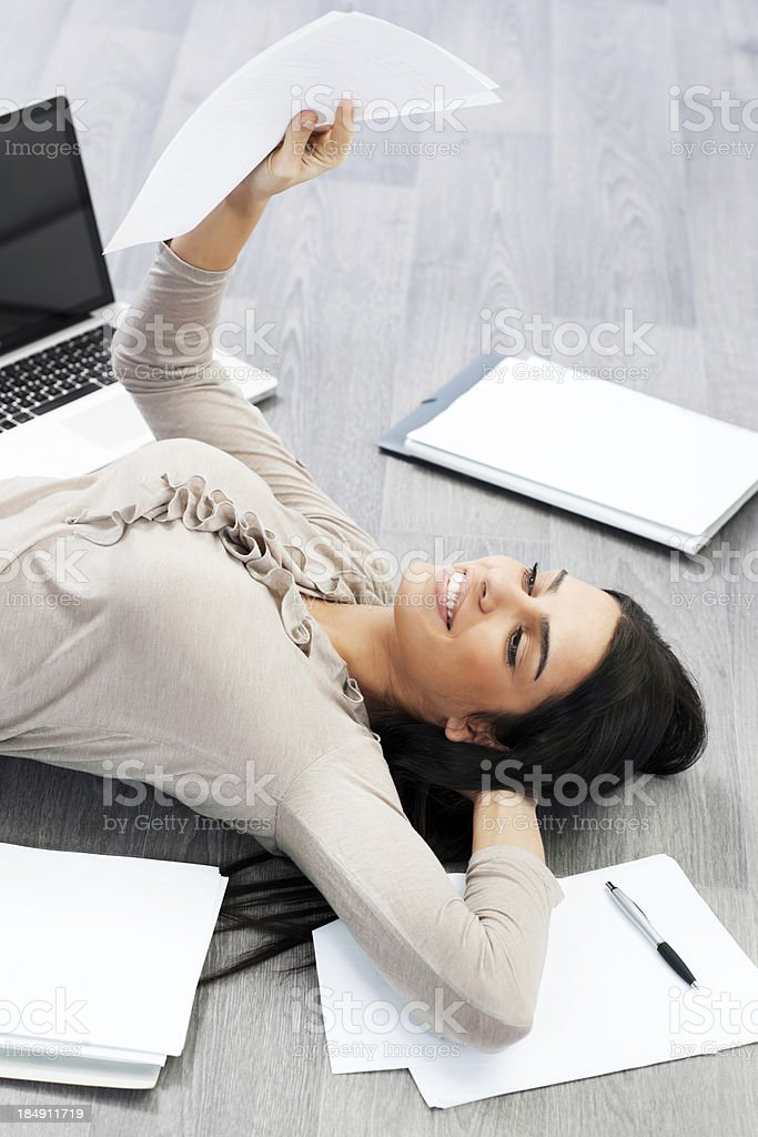 Cheerful businesswoman reading a report. royalty-free stock photo