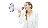 Cheerful businesswoman shouting with megaphone