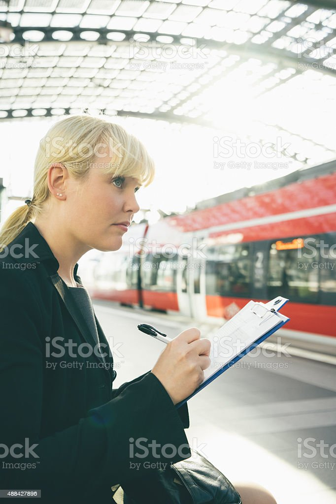 Cheerful Businesswoman Taking Notes stock photo