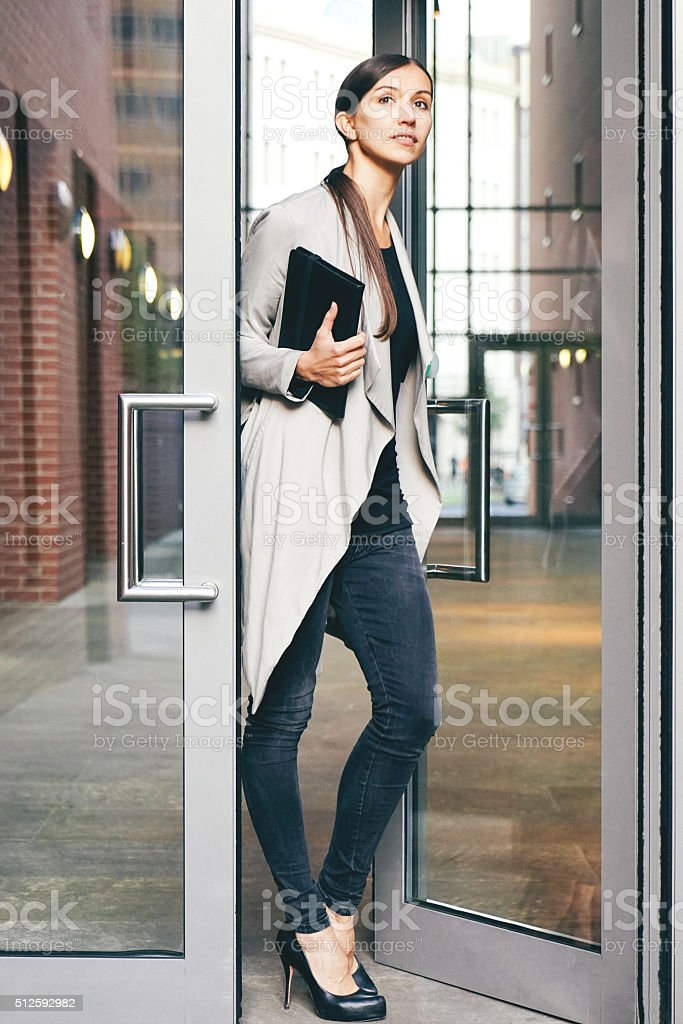 Cheerful Businesswoman Using Digital Tablet During Coffee Break stock photo