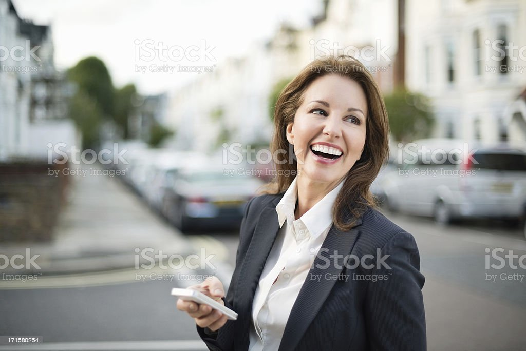 cheerful businesswoman using technology royalty-free stock photo