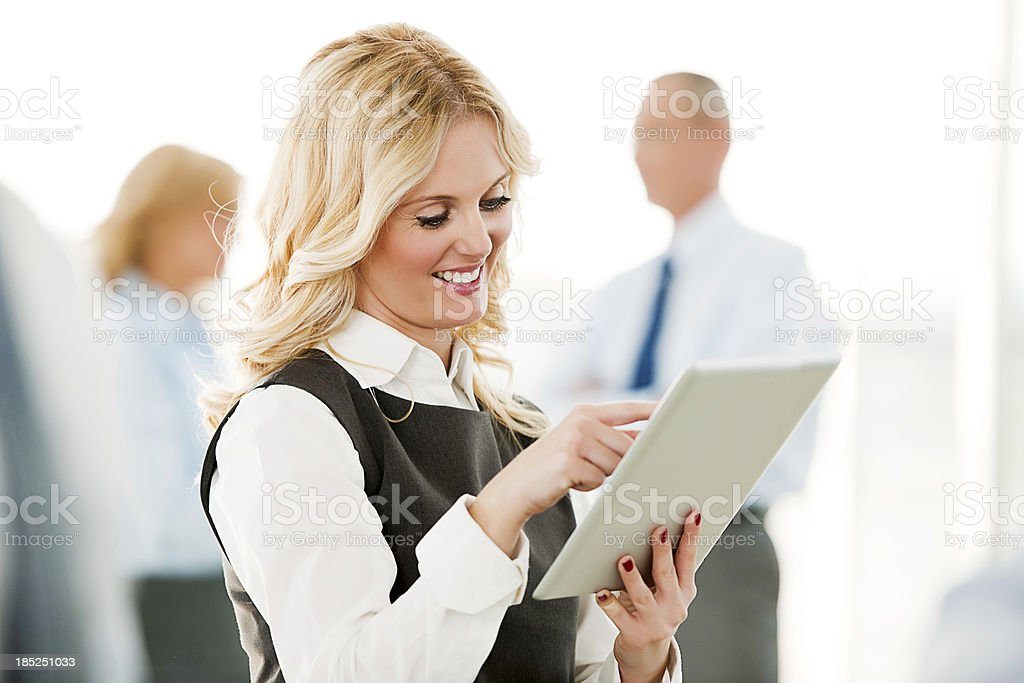 Cheerful businesswoman working on a digital tablet. royalty-free stock photo