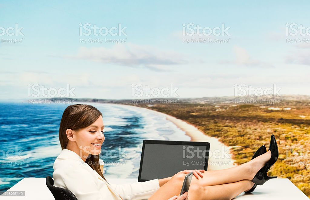 Cheerful businesswoman working outdoor stock photo