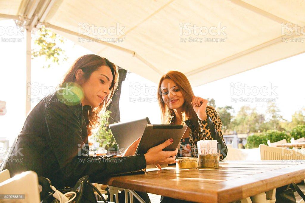 Cheerful Businesswomen Having A Meeting In A Cafè stock photo