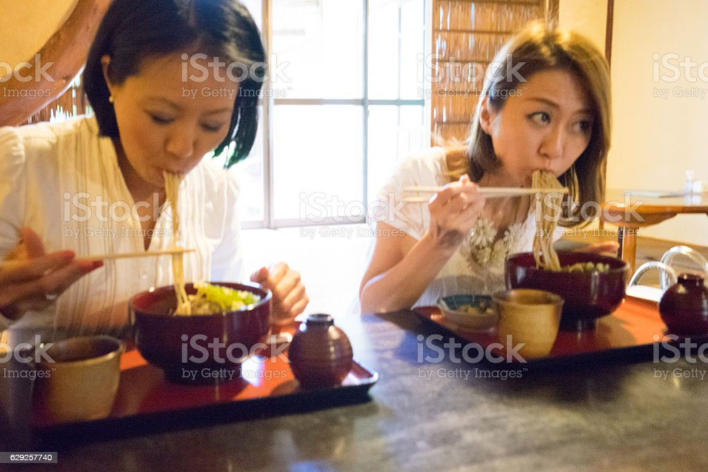 Cheerful businesswomen meeting over lunch in a Japanese restaurant stock photo