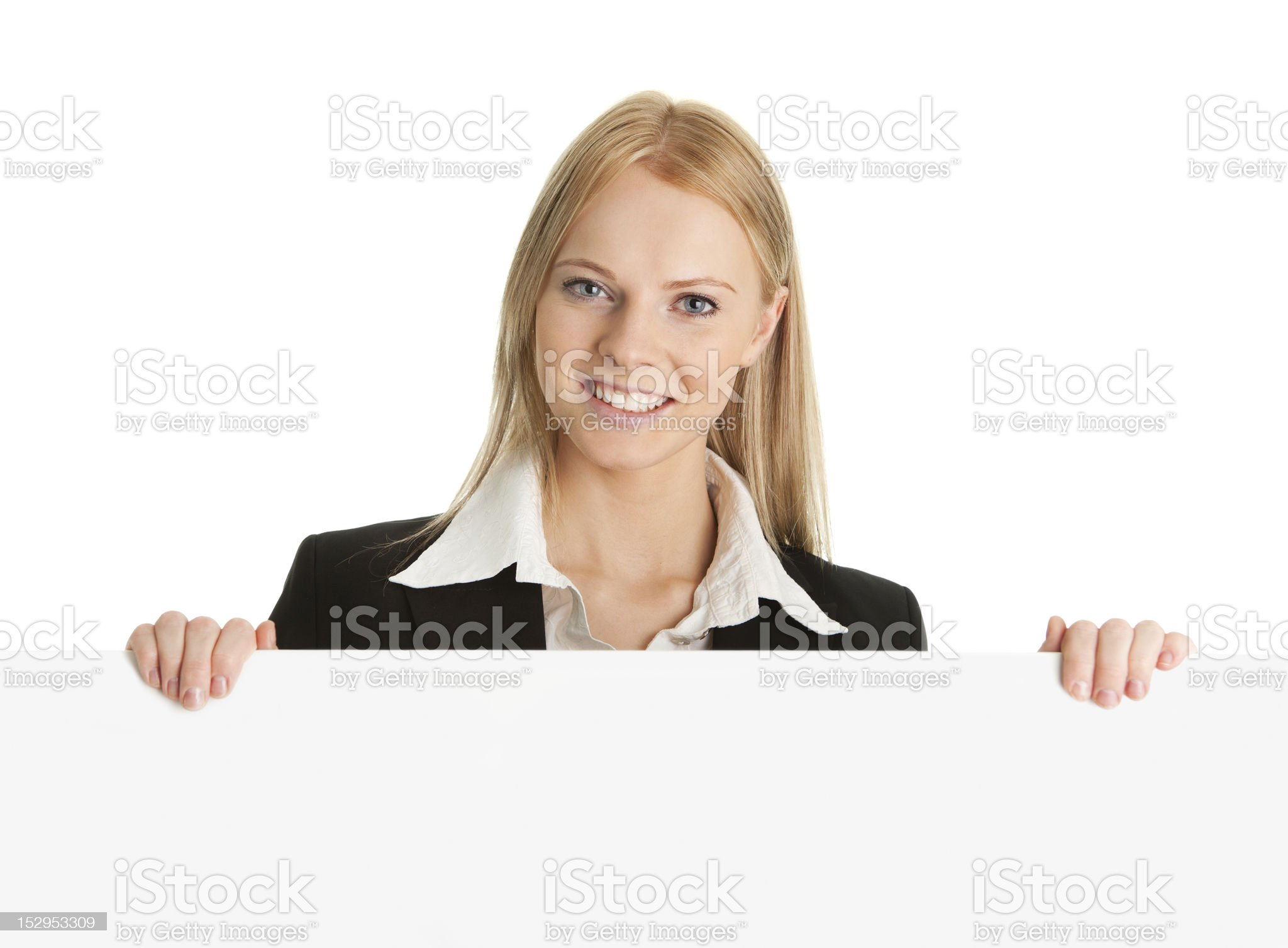 Cheerful businesswomen presenting empty board royalty-free stock photo