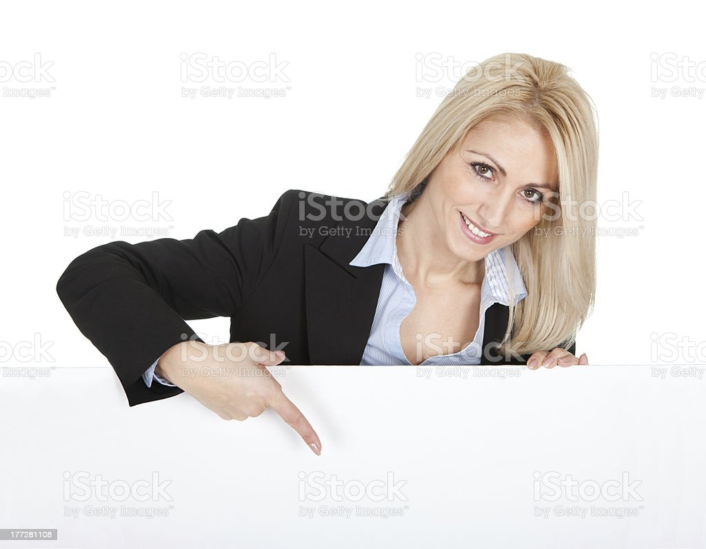 Cheerful businesswomen presenting empty board royalty-free stock photo