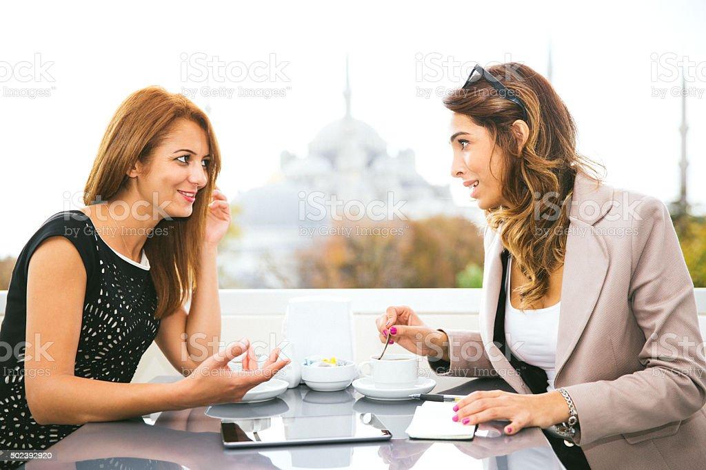 Cheerful Businesswomen Working At Cafè stock photo