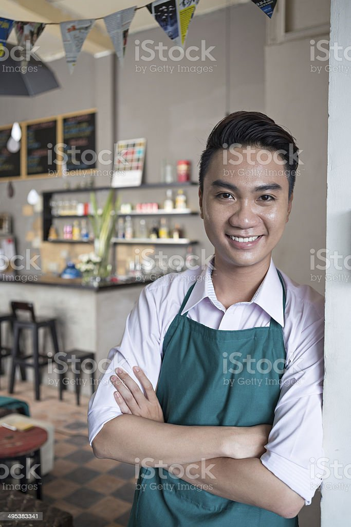 Cheerful cafe owner royalty-free stock photo