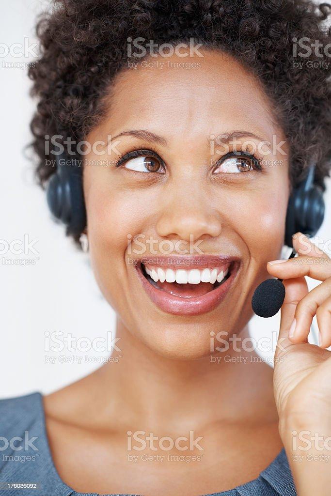 Cheerful call center executive stock photo