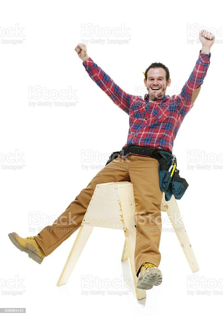 Cheerful carpenter cheering stock photo