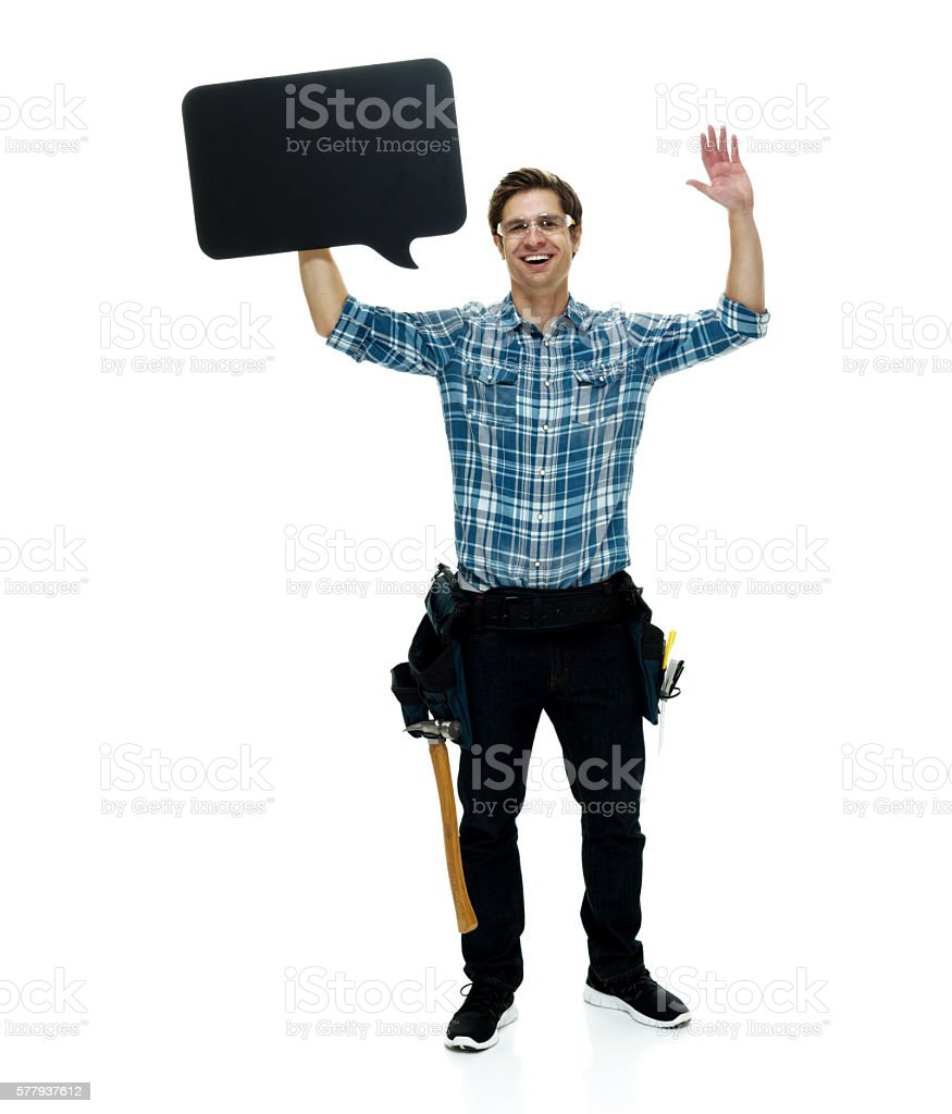 Cheerful carpenter holding speech bubble stock photo