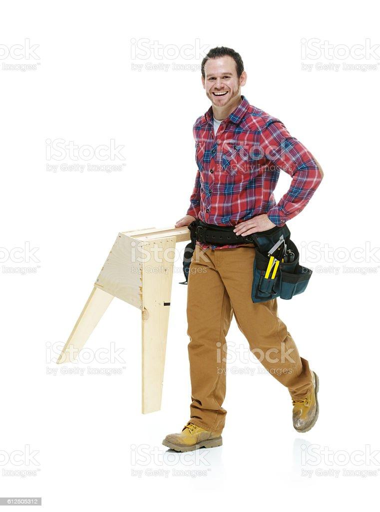 Cheerful carpenter walking stock photo